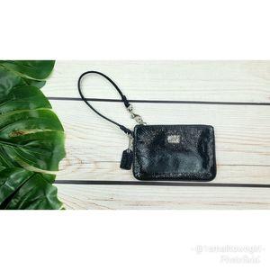 Coach Poppy patent leather wristlet black